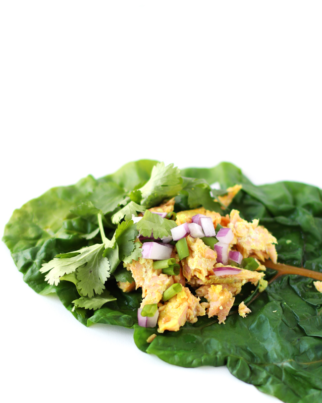Rainbow chard leaf filled with baked salmon, red onion, green onion, and fresh cilantro.