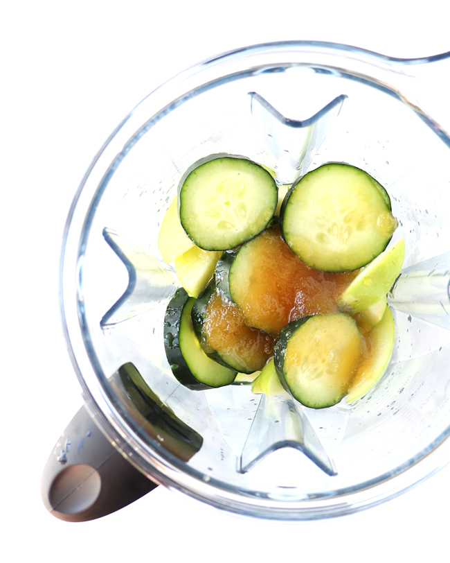 Cucumbers, honey, lime juice, and green apples in a Vitamix.