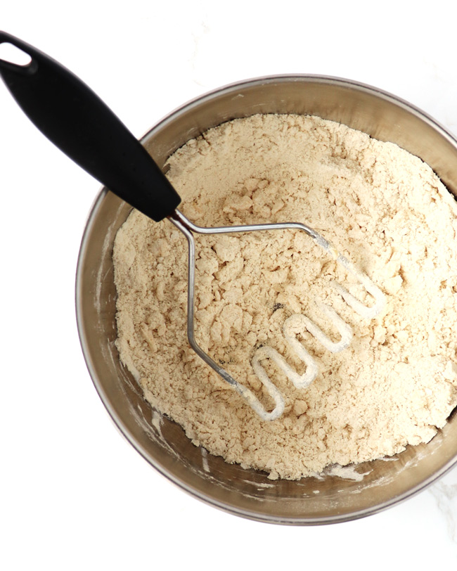 Gluten-free muffin mixture in a stainless steel bowl.