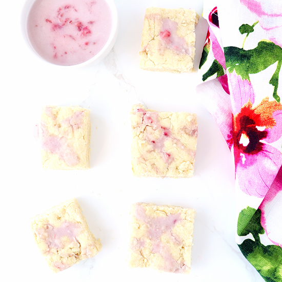 Gluten-Free Strawberry Shortcake Bars next to a pink and green floral napkin.