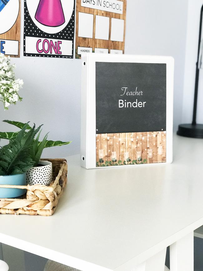 Festive Farmhouse teacher binder cover on a white desk.